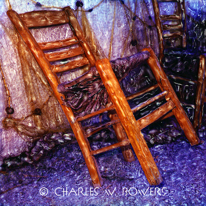 The chair waits for the fisherman to return to repair the nets.