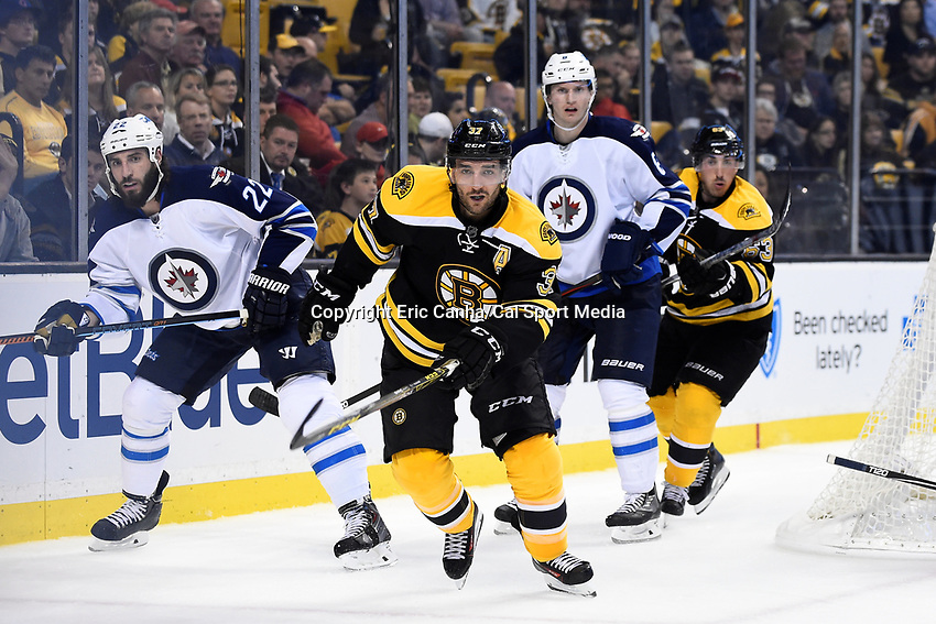 Thursday, October 8, 2015: Boston Bruins center Patrice Bergeron (37) watches the track of the  puck during the NHL game between the Winnipeg Jets and the Boston Bruins held at TD Garden, in Boston, Massachusetts. Winnipeg defeated Boston 6-2 in regulation time. Eric Canha/CSM