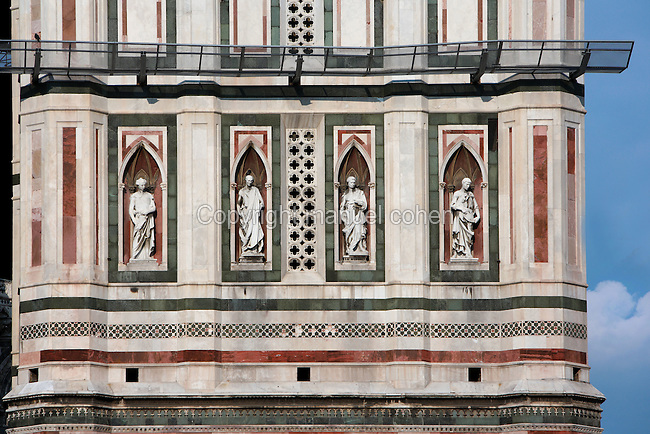 Cathedral Santa Maria del Fiore, Florence, Italy , also known as the Duomo, begun in 1296 by Arnolfo di CAMBIO, dome by Filippo BRUNELLESCHI, 1377-1446, completed in 1436. Detail of statues, 1408-21, on the East side of the Campanile, above the door, copies of, left to right: Beardless Prophet by DONATELLO, 1386-1466, a portrait of his friend Filippo Brunelleschi; Bearded Prophet by Nanni di BARTOLO, 15th century; Abraham Sacrificing Isaac by DONATELLO and Nanni di BARTOLO; Il Pensatore or The Thinker, by DONATELLO. The Campanile was designed by GIOTTO, 1267-1337, pictured on June 8 2007.