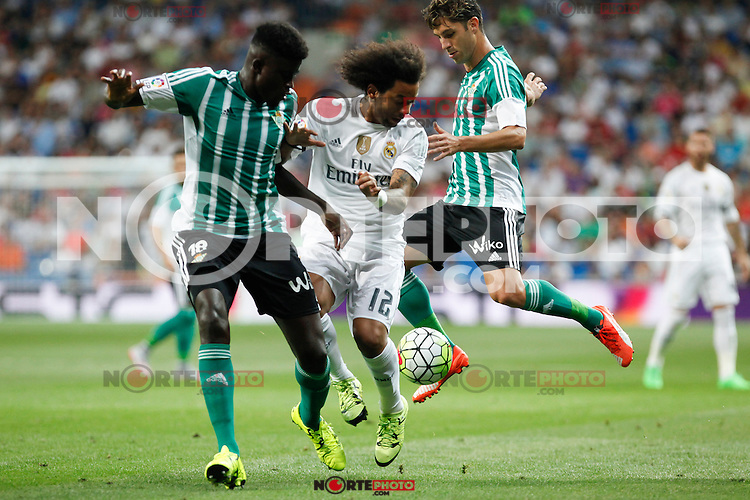 Real Madrid´s Marcelo Vieira and Real Betis´s N´diaye during La Liga match at Santiago Bernabeu stadium in Madrid, Spain. August 29, 2015. (ALTERPHOTOS/Victor Blanco)
