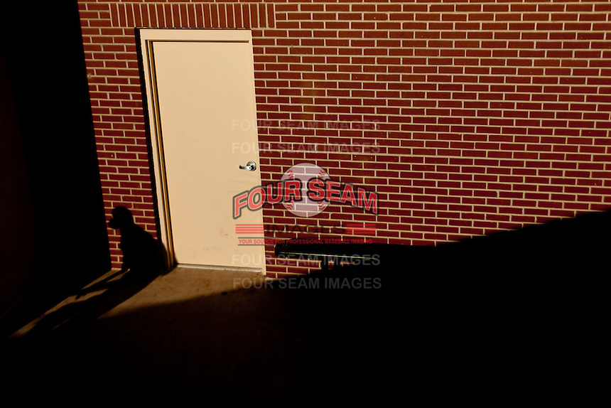 A Springfield Cardinals player walks out of the team locker room prior to a game against the Springfield Cardinals at Hammons Field on July 18, 2011 in Springfield, Missouri. Tulsa defeated Springfield 13-8. (David Welker / Four Seam Images)