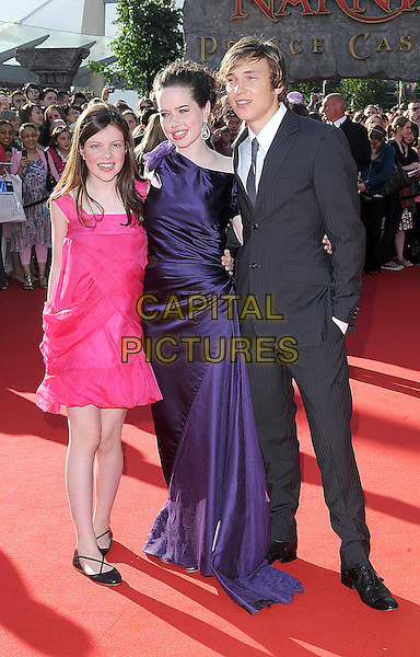 "GEORGIE HENLEY, ANNA POPPLEWELL & WILLIAM MOSELEY.attending the European Premiere of ""The Chronicles Of Narnia: Prince Caspian"" at the O2 Arena, London, England, 19th June 2008..full length pink purple long dress off the shoulder earrings suit.CAP/BEL.©Tom Belcher/Capital Pictures"