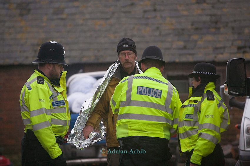 Partick  of the Combe Haven defenders is arrested for protesting in a tree at the site of the Bexhill tpo Hastings bypass .  The controversial proposed route cuts through an  area of outstanding natural beauty and has outraged many local people. It will cos tthe taxpayer over £100 million
