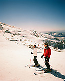 ARGENTINA, Bariloche, Cerro Cathedral, couple people skiing on snow covered landscape