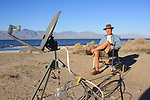 Man camping with TV dish at Salton Sea SRA