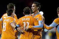 Brad Davis (11) celebrates with his teammates after scoring in th 36th minute. San Jose Earthquakes defeated Houston Dynamo 3-2 at Buck Shaw Stadium in Santa Clara, California on March 28th, 2009.