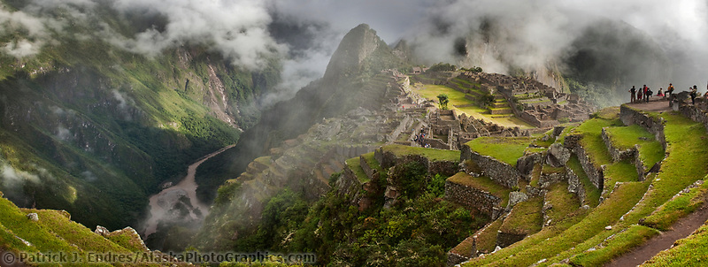 "Huayanapichu (young mountain) in the distance at Machu Picchu, the ancient ""lost city of the Incas"", 1400 CA, 2400 meters. Discovered by Hiram Bingham in 1911. Urubamba river in the distance."