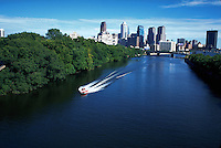 Speedboat in Schuylkill River, skyline of Philadelphia in background, Pennsylvania