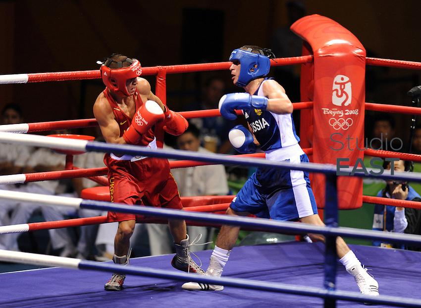 Russia's Albert SELIMOV (in blue) fights Ukraine's Vasyl LOMACHENKO (in red)