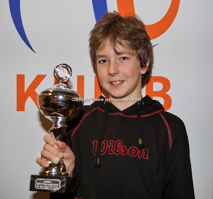 Almere, Netherlands, December 6, 2015, Winter Youth Circuit, winner boys12 years:  Luka Novakovic with the trophy<br /> Photo: Tennisimages/Henk Koster