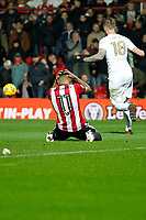 Ollie Watkins of Brentford has his head in his hands after missing the penalty during the Sky Bet Championship match between Brentford and Leeds United at Griffin Park, London, England on 4 November 2017. Photo by Carlton Myrie.