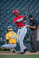 AZL Angels left fielder William Rivera (9) follows through on a practice swing during an Arizona League game against the AZL Athletics at Tempe Diablo Stadium on June 26, 2018 in Tempe, Arizona. The AZL Athletics defeated the AZL Angels 7-1. (Zachary Lucy/Four Seam Images)