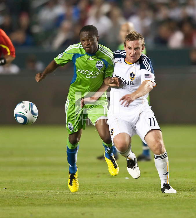 Seattle Sounders midfielder Steve Zakuani (11) and LA Galaxy midfielder Chris Birchall (11) battle for the ball during the second half of the game between LA Galaxy and the Seattle Sounders at the Home Depot Center in Carson, CA, on July 4, 2010. LA Galaxy 3, Seattle Sounders 1.
