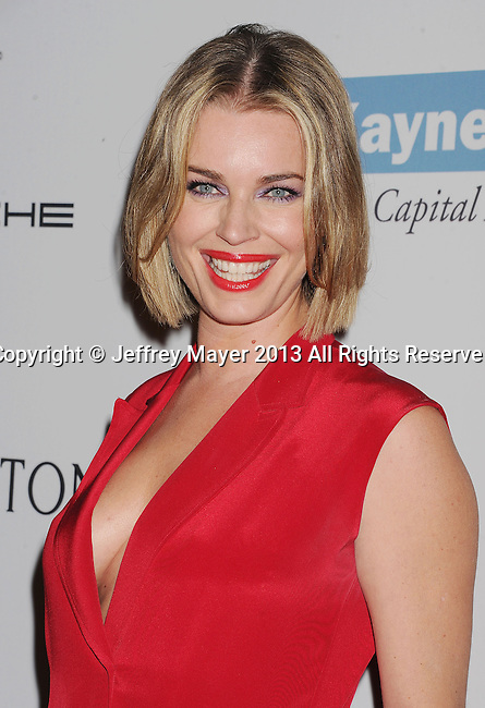 CULVER CITY, CA- NOVEMBER 09: Actress/model Rebecca Romijn arrives at the 2nd Annual Baby2Baby Gala at The Book Bindery on November 9, 2013 in Culver City, California.