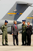 """Charleston AFB, SC - July 24, 2007 -- Colonel Mark Brauknight, 315th Airlift Wing acting commander, United States President George W. Bush, Colonel John """"Red"""" Millander, 437th Airlift Wing commander, and United States Senator Lindsey Graham (Republican of South Carolina) tour the Charleston Air Force Base, South Carolina flightline on Tuesday, July 24, 2007.  President Bush visited Charleston AFB, took a tour of a static C-17, ate lunch with Airmen from the base and talked about the Global War on Terrorism. <br /> Mandatory Credit: Nicholas J. Pilch - USAF via CNP"""