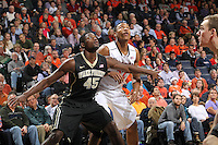 Wake Forest forward Arnaud William Adala Moto (45) looks for the rebound next to Virginia forward Darion Atkins (32) during the game Wednesday Jan. 08, 2014 in Charlottesville, Va. Virginia defeated Wake Forest 74-51.