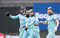 Adil Rashid (England) is congratulated by team mates as they celebrate the wicket of Carey during Australia vs England, ICC World Cup Semi-Final Cricket at Edgbaston Stadium on 11th July 2019