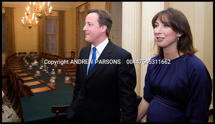 Britain's new Prime Minister David Cameron with his wife Samantha in the Cabinet room in Number 10 Downing Street for the first time, Tuesday May 11, 2010 . Photo By Andrew Parsons