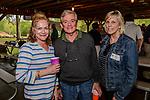 WATERTOWN, CT. 17 May 2018-051718BS92 - From left, Carol Mambruno of Waterbury, Dave Theroux of Middlebury, and Gale Neumann of Middlebury at the Greater Waterbury Campership Fund's Big Green Pizza Truck Party at the YMCA'S Camp Mataucha on Thursday evening. Bill Shettle Republican-American