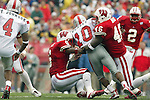Madison, Wisconsin - 9/13/03. University of Wisconsin defensive back Brett Bell (6 and linebacker Jeff Mack (46) tackle UNLV running back Dominique Dorsey (10) during the game at Camp Randall Stadium. UNLV beat Wisconsin 23-5. (Photo by David Stluka)