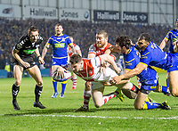 Picture by Allan McKenzie/SWpix.com - 09/03/2018 - Rugby League - Betfred Super League - Warrington Wolves v St Helens - Halliwell Jones Stadium, Warrington, England - Warrington's Stefan Ratchford & Ryan Atkins can't prevent St Helens' Mark Percival from scoring a try.