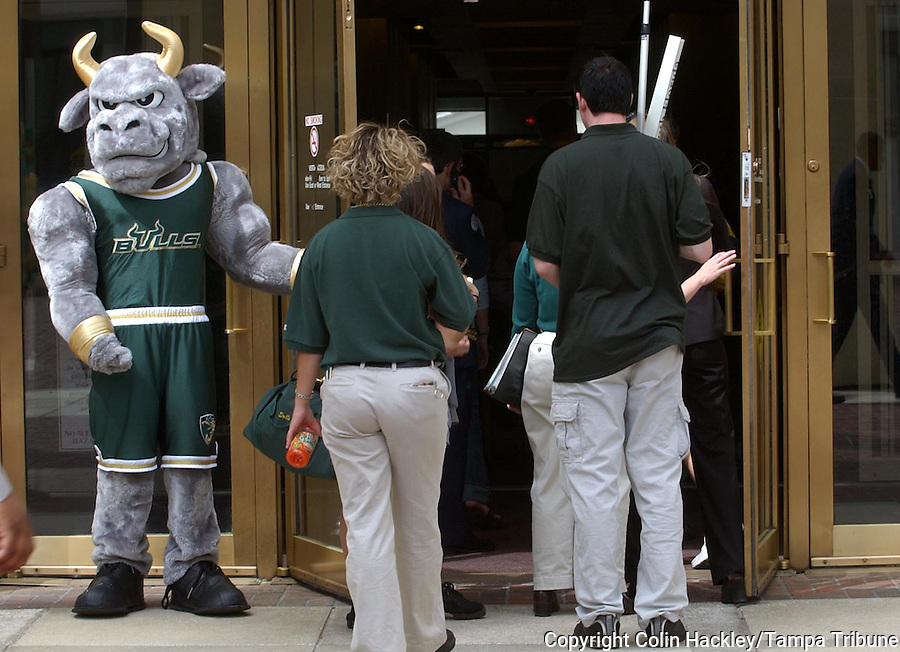 TALLAHASSEE, FL. 3/30/04-Rocky the Bull, a.k.a. Rich Bosaaen, (CQ) a USF senior from Spokane, Wash., holds the front door of the Capitol for fellow students as they enter for USF day at the Capitol Tuesday in Tallahassee. COLIN HACKLEY PHOTO