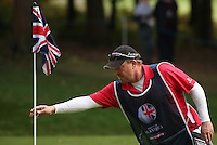 Caddie John Rawlings has his hands on the pin on the 17th during the Final Round of the British Masters 2015 supported by SkySports played on the Marquess Course at Woburn Golf Club, Little Brickhill, Milton Keynes, England.  11/10/2015. Picture: Golffile | David Lloyd<br /> <br /> All photos usage must carry mandatory copyright credit (&copy; Golffile | David Lloyd)