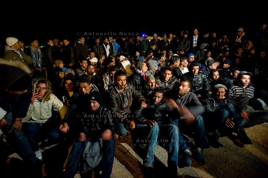 Immigrati Tunisini appena sbarcati sul molo del porto di Lampedusa.