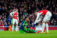 Leroy Fer of Swansea City  sits injured on the floor during the Barclays Premier League match between Arsenal and Swansea City at the Emirates Stadium, London, UK, Wednesday 02 March 2016