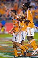 Houston Dynamo forward Brian Ching (25), forward Joseph Ngwenya (33) and midfielder Brian Mullan (9) celebrate a goal.  Houston Dynamo defeated FC Dallas 4-1 at Robertson Stadium in Houston, TX on November 2, 2007.  Houston Dynamo won the Western Conference semifinal series with an aggregate score of 4-2.