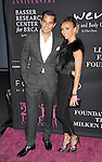 SANTA MONICA, CA- OCTOBER 18: TV personalities Bill Rancic (L) and Giuliana Rancic attend Elyse Walker presents the 10th anniversary Pink Party hosted by Jennifer Garner and Rachel Zoe at HANGAR 8 on October 18, 2014 in Santa Monica, California.