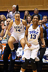 07 January 2016: Duke's Faith Suggs (14) and Crystal Primm (13) cheer on their teammates. The Duke University Blue Devils hosted the Wake Forest University Demon Deacons at Cameron Indoor Stadium in Durham, North Carolina in a 2015-16 NCAA Division I Women's Basketball game. Duke won the game 95-68.