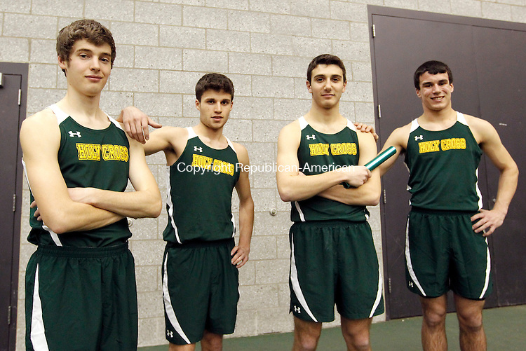 New Haven, CT- 09, February 2011-020911CM10 Holy Cross' Dan Creem, Patsy Casalino, Adam Quicquaro and Matthew Satkowski set the NVL meet record in the 4x800m relay during the NVL Track and Field Championships Wednesday afternoon in New Haven.  Christopher Massa Republican-American