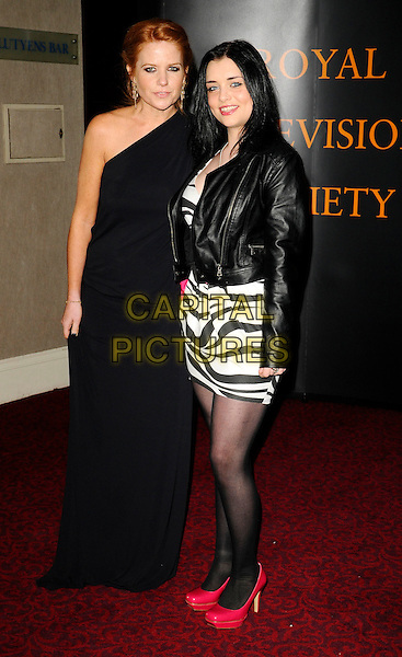 PATSY PALMER & SHONA McGARTY.RTS Programme Awards 2009, Grosvenor House Hotel, Park Lane, London, England, UK, 17th March 2009..full length black dress one shoulder long maxi red shoes square toe leather jacket long maxi white zebra print mini patent platform .CAP/CAN.©Can Nguyen/Capital Pictures