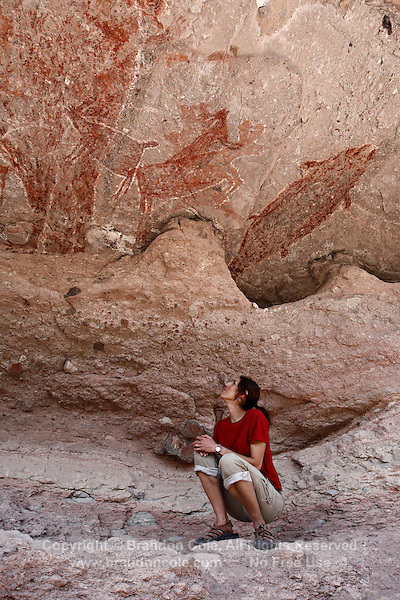 pr7181-D. woman (model released) admires petroglyphs and rock paintings of Santa Marta, which depict people, animals (deer, rabbits, fish, more). Baja, Mexico. .Photo Copyright © Brandon Cole. All rights reserved worldwide.  www.brandoncole.com..This photo is NOT free. It is NOT in the public domain. This photo is a Copyrighted Work, registered with the US Copyright Office. .Rights to reproduction of photograph granted only upon payment in full of agreed upon licensing fee. Any use of this photo prior to such payment is an infringement of copyright and punishable by fines up to  $150,000 USD...Brandon Cole.MARINE PHOTOGRAPHY.http://www.brandoncole.com.email: brandoncole@msn.com.4917 N. Boeing Rd..Spokane Valley, WA  99206  USA.tel: 509-535-3489