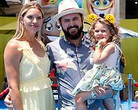 "LOS ANGELES - JUL 23:  Abigail Ochse, AJ Buckley, Willow Phoenix Buckley at ""The Emoji Movie"" Premiere at the Village Theater on July 23, 2017 in Westwood, CA"