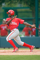 Luis Paulino #80 of the GCL Phillies follows through on his swing versus the GCL Braves at Disney's Wide World of Sports Complex, July 13, 2009, in Orlando, Florida.  (Photo by Brian Westerholt / Four Seam Images)