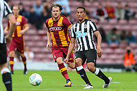 Isaac Hayden of Newcastle United and Jake Reeves of Bradford City during the pre season friendly match between Bradford City and Newcastle United at the Northern Commercial Stadium, Bradford, England on 26 July 2017. Photo by Thomas Gadd.