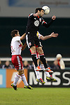 03 November 2012: DC's Chris Pontius (right) heads the ball over New York's Connor Lade (left). DC United played New York Red Bulls at RFK Stadium in Washington, DC in the first leg of their 2012 MLS Cup Playoffs Eastern Conference Semifinal series. The game ended in a 1-1 tie.