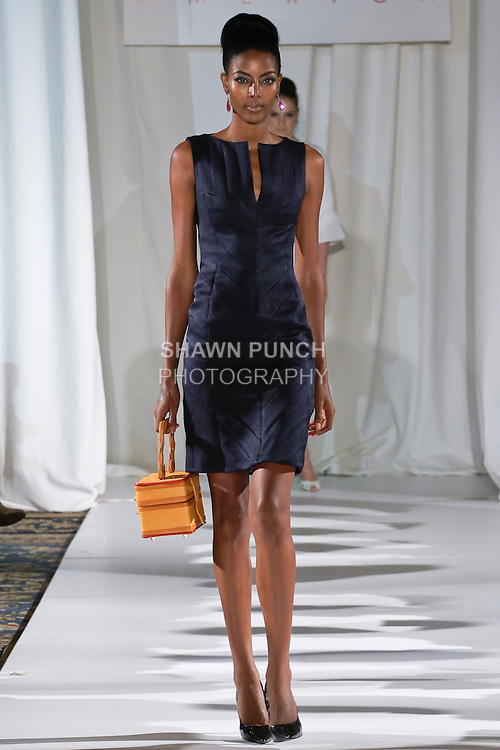 Gate walks runway in a navy cobra embossed silk architectural sheath, from the b Michael AMERICA Couture Spring 2013 collection during Mercedes-Benz Fashion Week Spring 2013, at the Jumeirah Essex House on September 12, 2012.