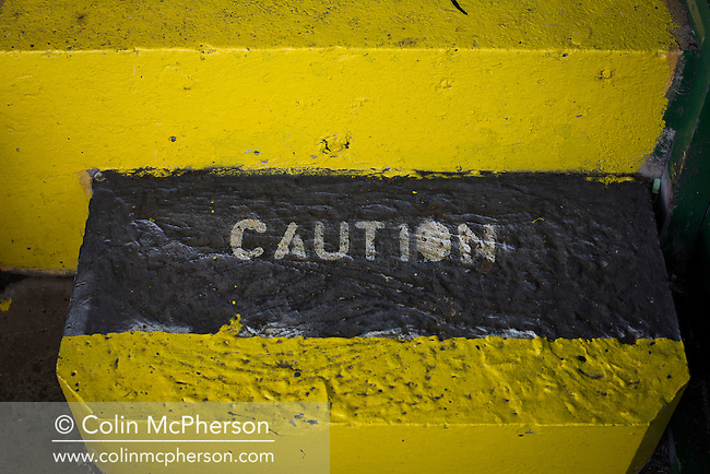 A step painted with the word 'caution' in the directors' box at The Oval, Belfast, pictured before Glentoran hosted city-rivals Cliftonville in an NIFL Premiership match. Glentoran, formed in 1892, have been based at The Oval since their formation and are historically one of Northern Ireland's 'big two' football clubs. They had an unprecendentally bad start to the 2016-17 league campaign, but came from behind to win this fixture 2-1, watched by a crowd of 1872.