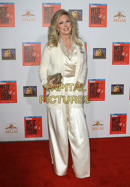 """Morgan Fairchild.""""West Side Story: 50th Anniversary""""  Blu-Ray Release Premiere Held At Grauman's Chinese Theatre, Hollywood, California, USA..November 15th, 2011.full length white cream silk satin wide leg flared trousers jacket gold clutch bag .CAP/ADM/KB.©Kevan Brooks/AdMedia/Capital Pictures."""