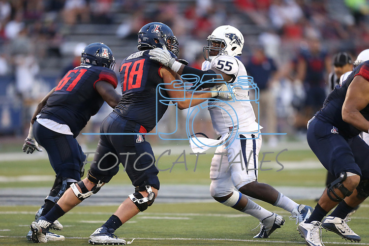 Arizona's Cayman Bundage (61) and Jacob Alsadek (78) compete against Nevada's Rykeem Yates (55) in an NCAA college football game in Reno, Nev., on Saturday, Sept. 12, 2015.(AP Photo/Cathleen Allison)
