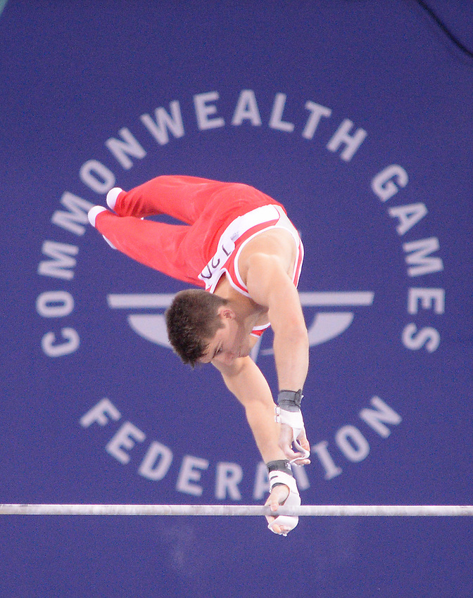 England's Max Whitlock during his performance on the horizontal bar during the men's all-round final<br /> <br /> Photographer Chris Vaughan/CameraSport<br /> <br /> 20th Commonwealth Games - Day 7 - Wednesday 30th July 2014 - Gymnastics - The SSE Hydro - Glasgow - UK<br /> <br /> © CameraSport - 43 Linden Ave. Countesthorpe. Leicester. England. LE8 5PG - Tel: +44 (0) 116 277 4147 - admin@camerasport.com - www.camerasport.com