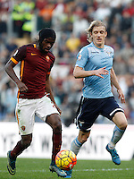 Calcio, Serie A: Roma vs Lazio. Roma, stadio Olimpico, 8 novembre 2015.<br /> Roma's Gervinho, left, is chased by Lazio's Dusan Basta during the Italian Serie A football match between Roma and Lazio at Rome's Olympic stadium, 8 November 2015.<br /> UPDATE IMAGES PRESS/Isabella Bonotto