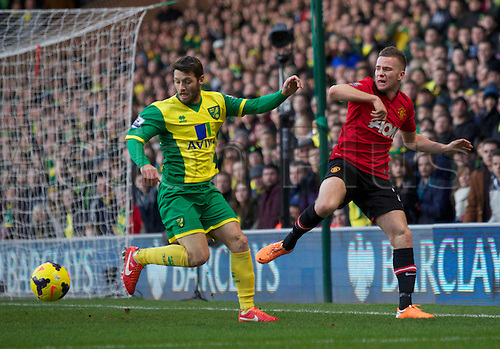 28.12.2013 Norwich, England.  Tom Cleverley of Manchester United and Wes Hoolahan of Norwich City during the Premier League game between Norwich City and Manchester United from Carrow Road Stadium.