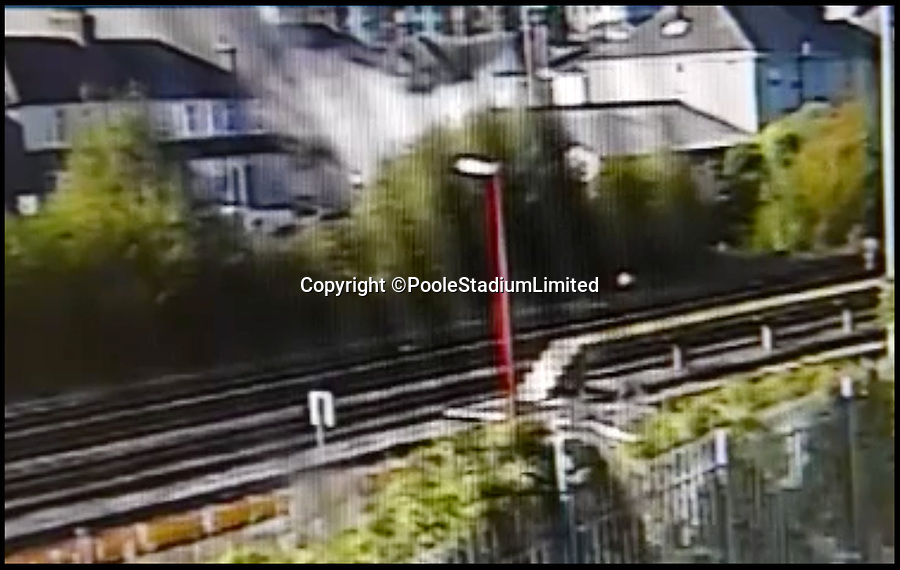 BNPS.co.uk (01202 558833)<br /> Pic:  PooleStadiumLimited/BNPS<br /> <br /> A still image from CCTV footage of the blast as the dust settles, as seen from a camera on Poole Stadium.<br /> <br /> A spurned husband who almost killed himself and his ex-wife when he deliberately blew up their house with them inside it is facing a lengthy jail term today.<br /> <br /> Ian Clowes appeared in court via a video link and pleaded guilty to a charge of arson in connection with the huge gas explosion that ripped apart the semi-detached property. <br /> <br /> The 67-year-old had divorced from his ex-wife Elaine and converted their marital home into two flats before he triggered the blast on October 22 last year.
