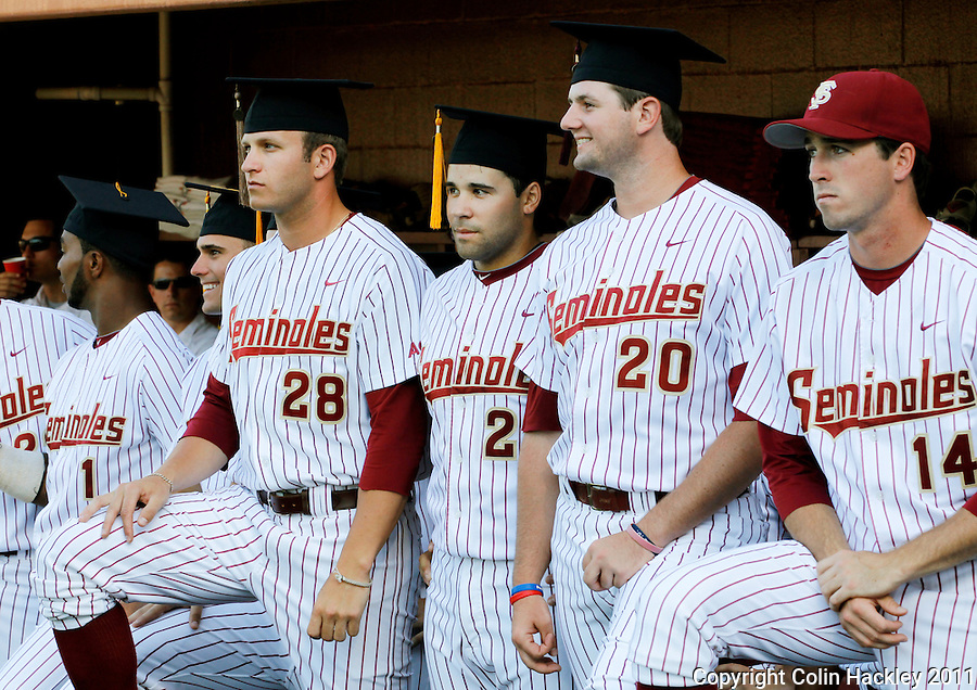 TALLAHASSEE, FL 5/7/11-FSU-UCFBASE11 CH-Florida State graduates Taiwan Easterling, left, Tyler Everett, Rafael Lopez, Daniel Bennett are joined by Tye Buckley as they await a ceremony honoring them before the University of Central Florida game Saturday at Dick Howser Stadium in Tallahassee. The Seminoles lost to the Knights 10-14..COLIN HACKLEY PHOTO