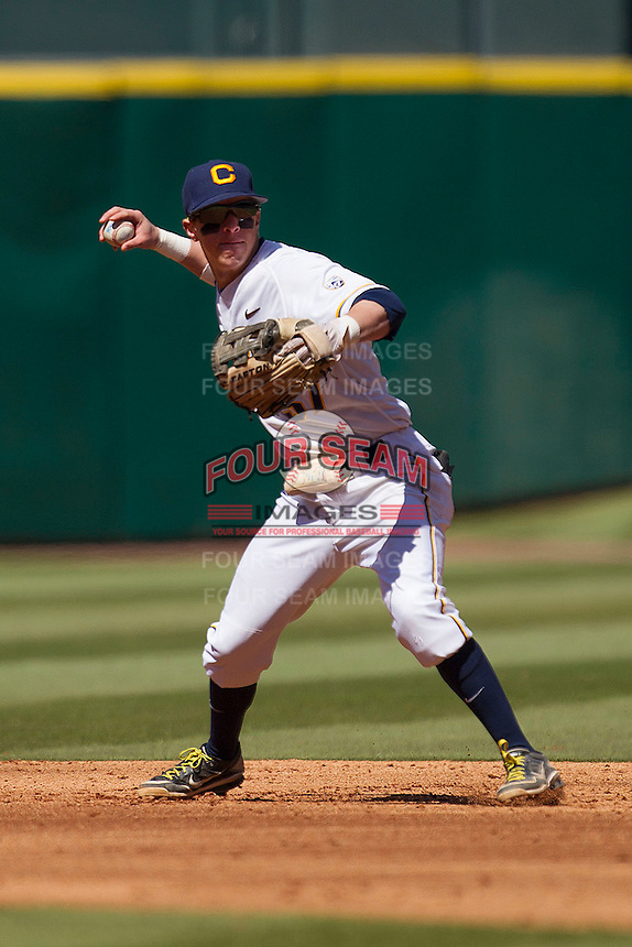 California Golden Bears shortstop Mike Reuvekamp #37 makes a throw to first base against the North Carolina Tar Heels in the NCAA baseball game on March 2nd, 2013 at Minute Maid Park in Houston, Texas. North Carolina defeated Cal 11-5. (Andrew Woolley/Four Seam Images).