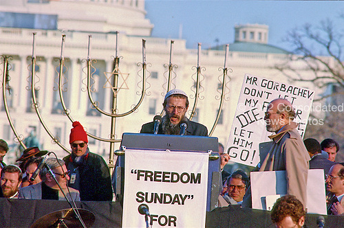 "Yosef Mendelevich makes remarks at the ""Campaign to the Summit"", a march on Washington, D.C. supporting freedom for Jews living in the Soviet Union, on Sunday, December 6, 1987. 200,000 people marched to focus attention on the repression of Soviet Jewry, was scheduled a day before United States President Ronald Reagan and Soviet President Mikhail Gorbachev began a 2 day summit in Washington where they signed the Intermediate Range Nuclear Forces (INF) Treaty.<br /> Credit: Ron Sachs / CNP"